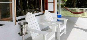 Adirondack Chairs on wrap around porch at the lodge